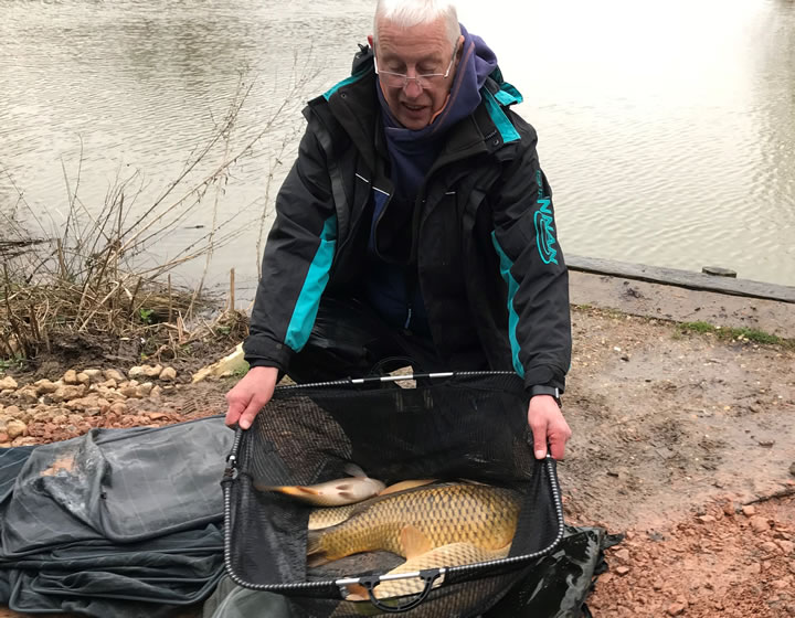 A very cold looking Mick with his winning catch