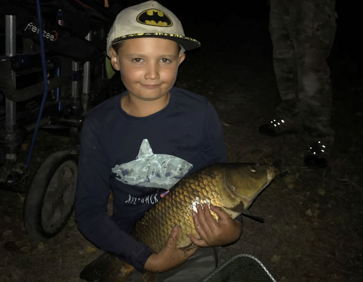 Young Cody proudly displays one of his carp