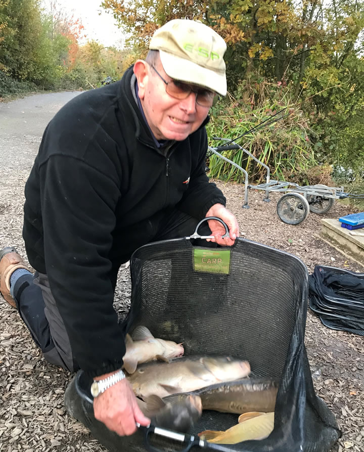 Phil with a few carp