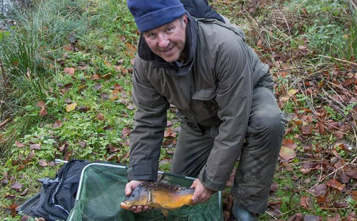 Steve's perseverance paid off when this small carp picked up his bait