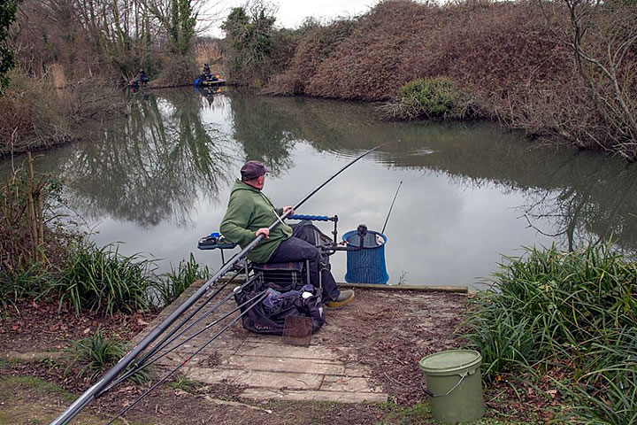 Vince battles with another carp to keep it out of the brambles